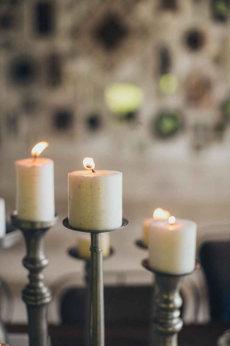 three lighted pillar candles